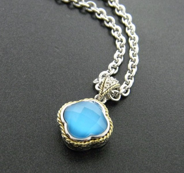 turquoise with a clear faceted quartz overlay fashioned in sterling