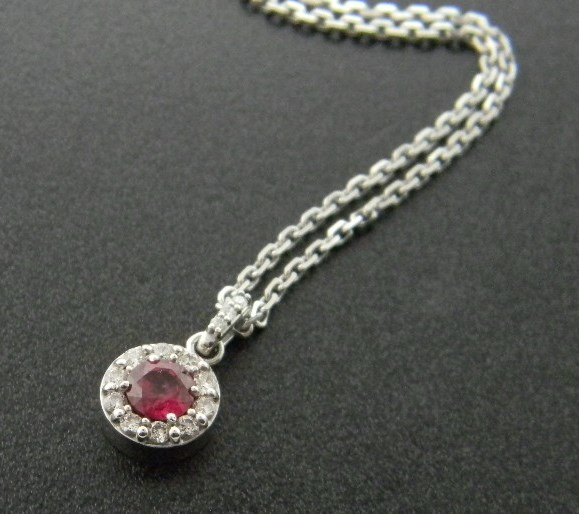 14 karat white gold madagascar ruby and diamond halo