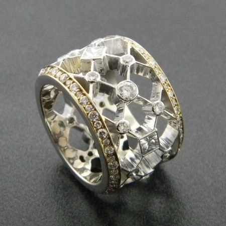 14 karat white and yellow gold eternity style ring with round and princess cut diamonds. Designed by Kurt Rose. *sold*