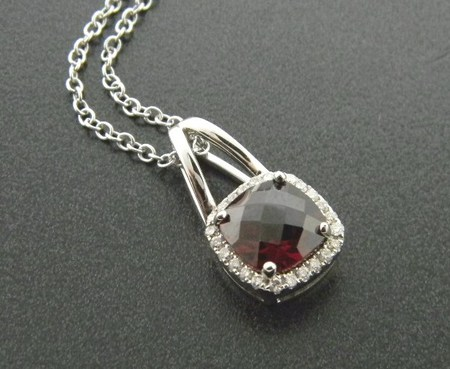 14 karat white gold pendant with a mozambique checkerboard garnet and