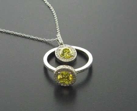 Enhanced vibrant yellow diamond ring and pendant with brilliant cut diamonds accents.