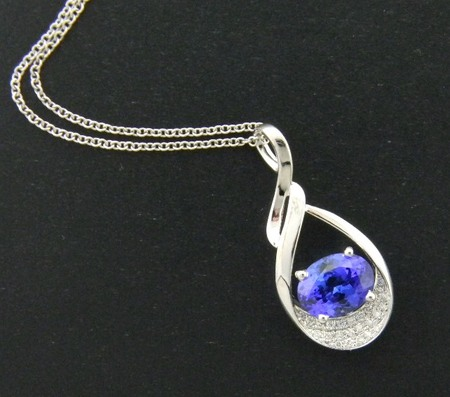 2.12 carat oval tanzanite accented with brilliant cut diamonds and fashioned in 14 karat white gold. Designed by Kurt Rose *sold*