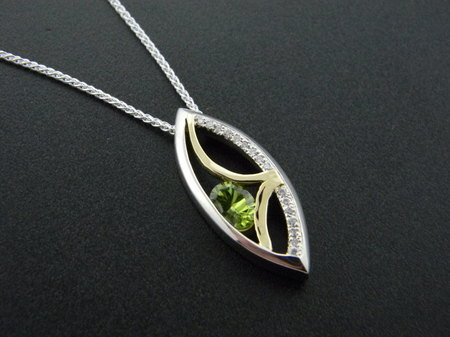 sterling silver and 18 karat yellow gold custom cut peridot and diamond pendant. Designed by Rick Little *sold*