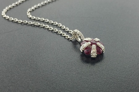 14 karat white gold pendant with carat ruby and carats