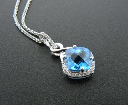 14 karat white gold necklace with a cushion cut swiss blue