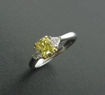 platinum and 18 karat yellow gold ring with a 1.09 carat, fancy intense natural yellow cushion cut diamond.