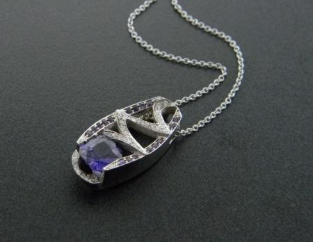 18 karat white gold color change purple sapphire and diamond necklace. Designed by Rick Little