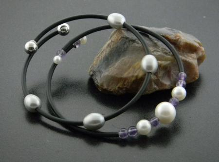 Freshwater cultured pearls and amethyst.