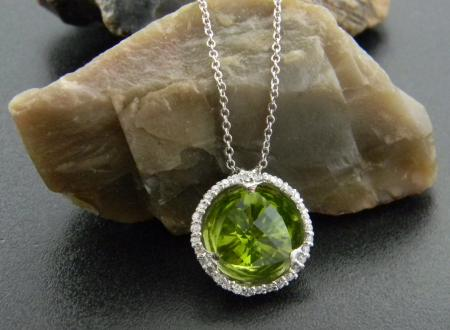 3.10 carat trillion peridot reflection necklace. Accented with brilliant cut diamonds, fashioned in 18 karat gold.