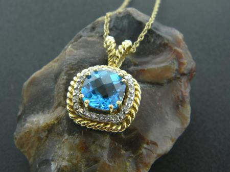 14 karat yellow gold, Swiss blue topaz, and diamond pendant necklace. Was $1250, now $750