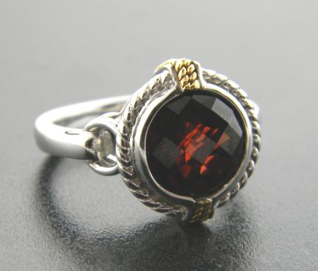 Sterling silver and 18 karat yellow gold with garnet stone. Was $330, now $198