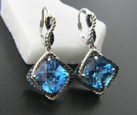 Sterling silver with cushion cut, checker faceted blue topaz and blue diamond accents. Was $1295, now $777.