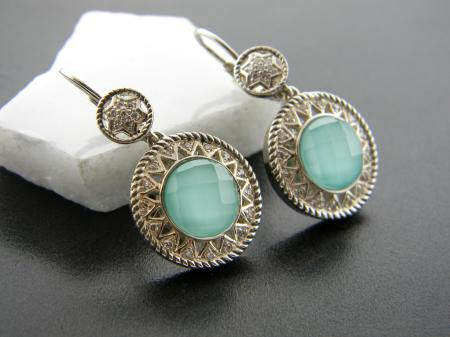 Sterling silver with turquoise and faceted clear quartz earrings with accent diamonds. Was $1200, now $720.