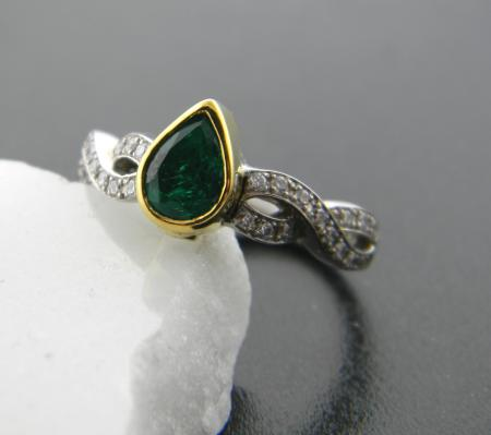 Palladium and gold ring with .63 carat emerald and diamond accented band. Size 6.5. Was $3255, now $1953