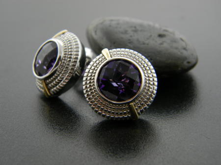 Sterling Silver and 18 karat gold amethyst earrings. Were $550, now $330