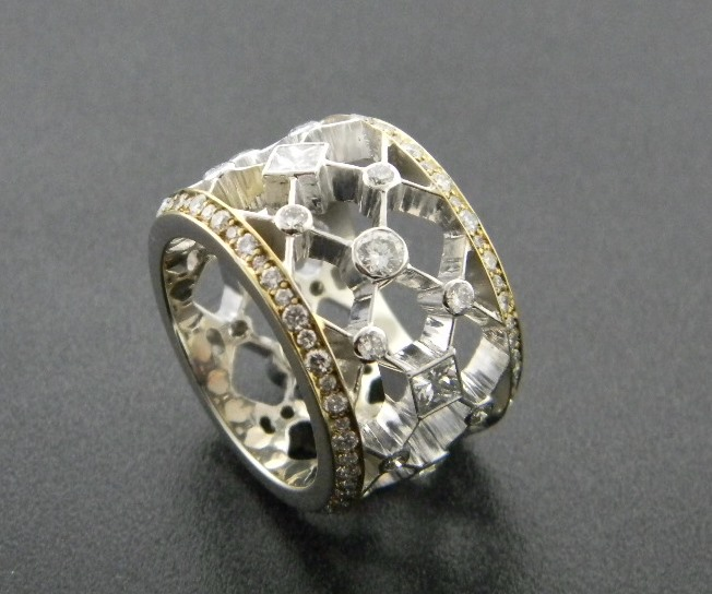 14 karat white and yellow gold eternity style ring with round and princess cut diamonds. Designed by Kurt Rose. *sold* : Aspen Originals : Aspen Jewelry Designs