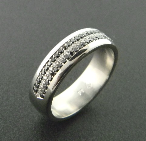 Gentleman's platinum wedding band with black and white brilliant cut diamonds. Designed by Rick Little. *sold* : Aspen Originals : Aspen Jewelry Designs