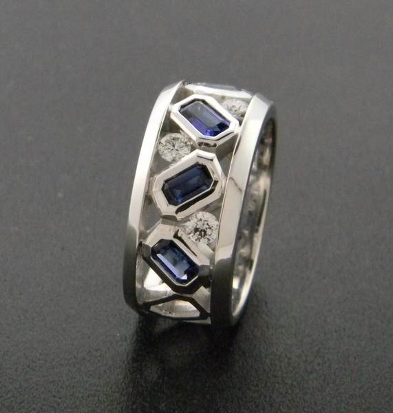 14 karat white ring with emerald cut vibrant blue sapphires and brilliant cut diamonds. Designed by Kurt Rose. *sold* : Aspen Originals : Aspen Jewelry Designs
