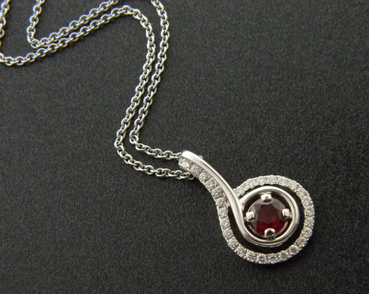 14 karat white gold ruby and diamond necklace. The round Madagascar ruby weighs  0.40 carat and the brilliant cut diamonds total 0.22 carat. : Gemstone : Aspen Jewelry Designs