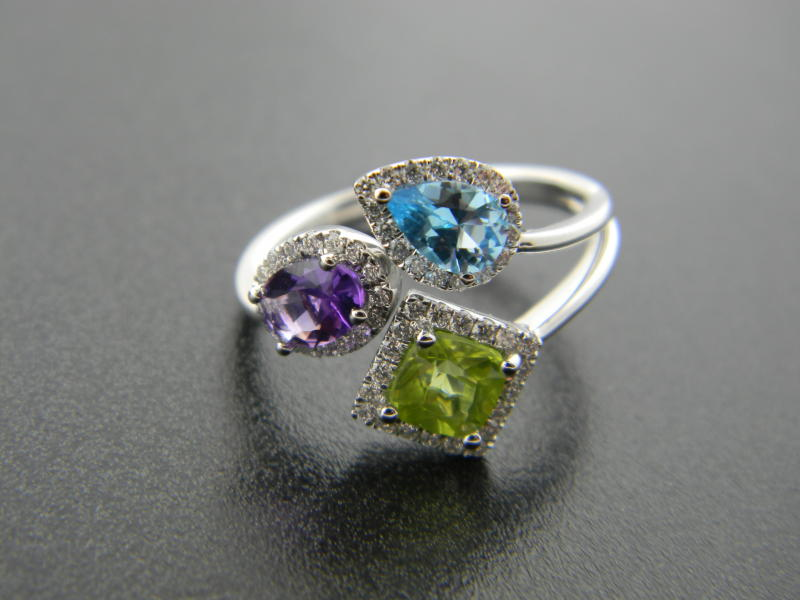 14 karat white gold amethyst, blue topaz and peridot totaling 1.44ct. Brilliant cut diamonds totaling 0.28ct : Gemstone : Aspen Jewelry Designs