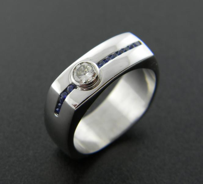 14 karat white gold gentleman's ring with a 0.31ct round brilliant diamond and 12 diamond cut blue sapphires. : Aspen Originals : Aspen Jewelry Designs
