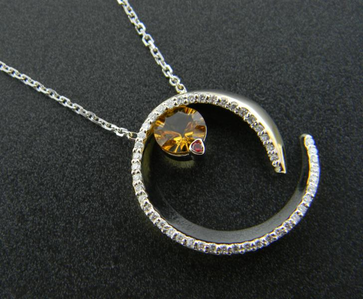18 karat white and yellow gold necklace with a custom cut 1.21 carat citrine, 37 brilliant cut diamonds totaling 0.35 carat red-orange sapphire accent. Custom designed.