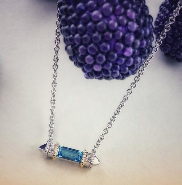 Sterling silver, 18 karat gold, blue topaz and diamond necklace