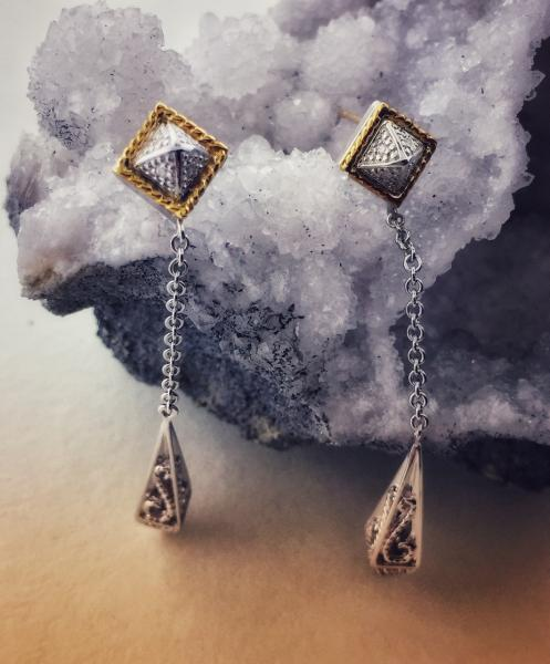 Sterling silver and 18 karat gold diamond dangle earrings. $450.00