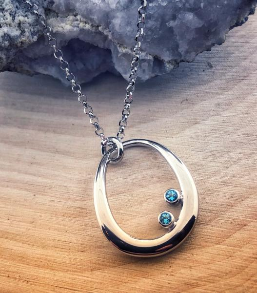 Sterling silver and Swiss blue topaz necklace. $210.00