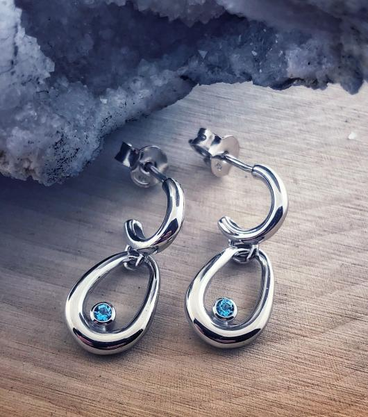Sterling silver and Swiss blue topaz earrings. $200.00