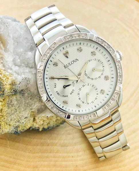 Ladies Bulova with a stainless steel case and bracelet. Diamond hour markers and bezel.