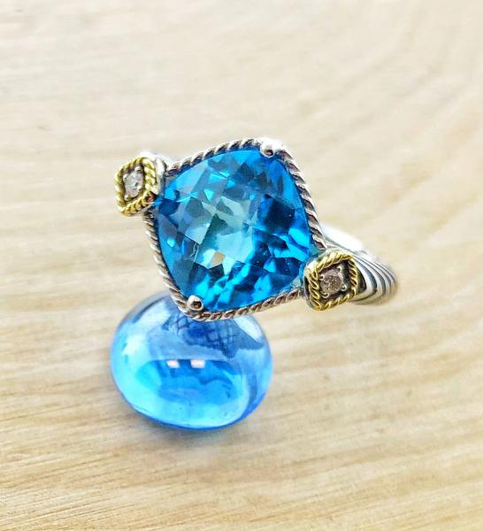 Sterling silver and 18 karat gold 5.50 carat Swiss blue topaz and diamond ring. $450.00