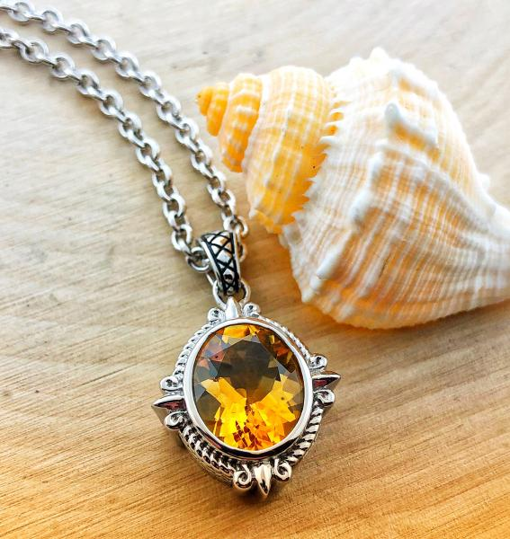 Sterling silver necklace with a 4.40 carat oval faceted citrine. $400.00