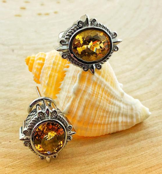 Oval citrines totaling 7 carats fashioned in sterling silver. $400.00