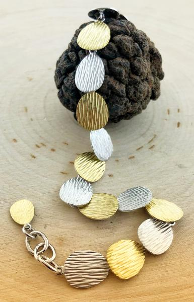 Sterling silver and yellow gold vermeil textured bracelet. $395.00