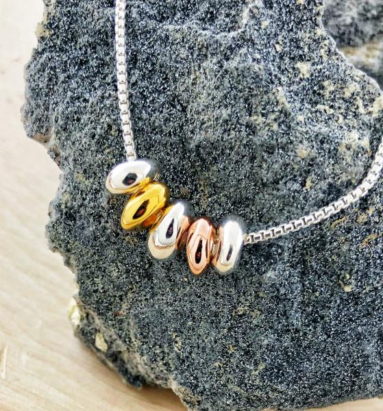 Sterling silver, rose gold vermeil and yellow gold vermeil pebble necklace. $130.00