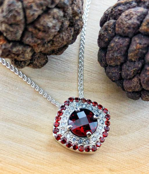 Custom designed, sterling silver garnet and lab diamond necklace. $450.00