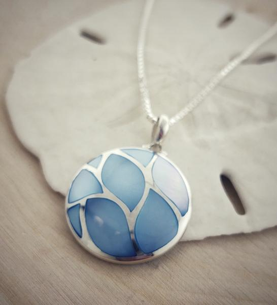 Sterling silver blue mother of pearl necklace. $160.00