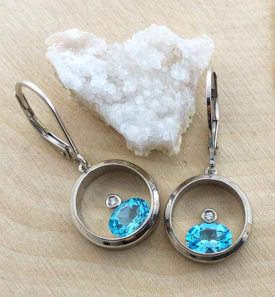 Sterling silver blue topaz and diamond earrings. And Aspen Original. $250.00