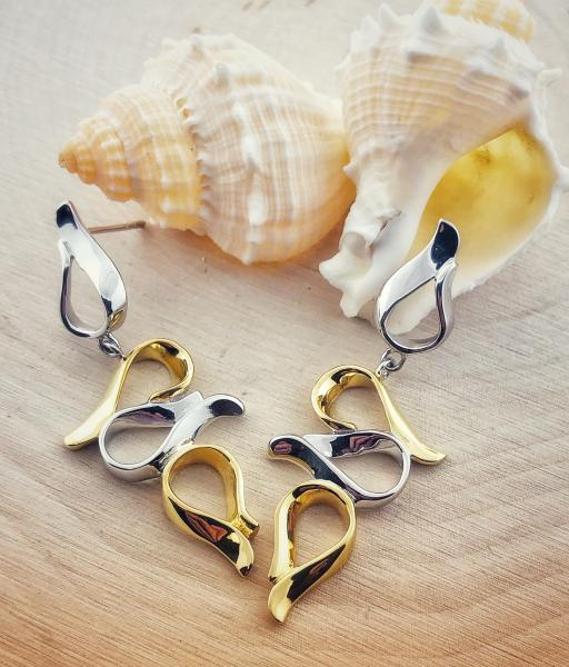 "Sterling silver and 18 karat vermeil ""flame"" dangle earrings. $210.00"