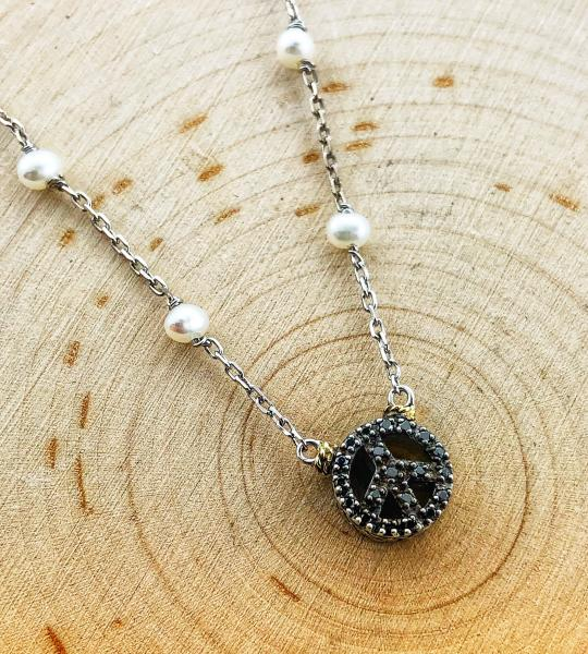 Sterling silver, freshwater pearl and black diamond peace sign necklace. $250.00