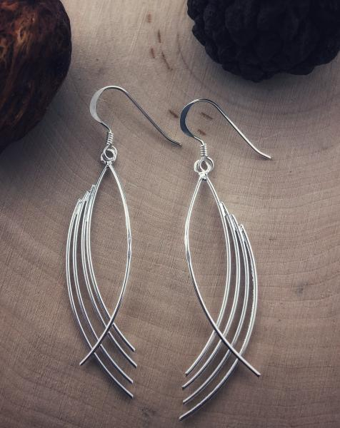 Sterling silver sweep dangle earrings. $45.00