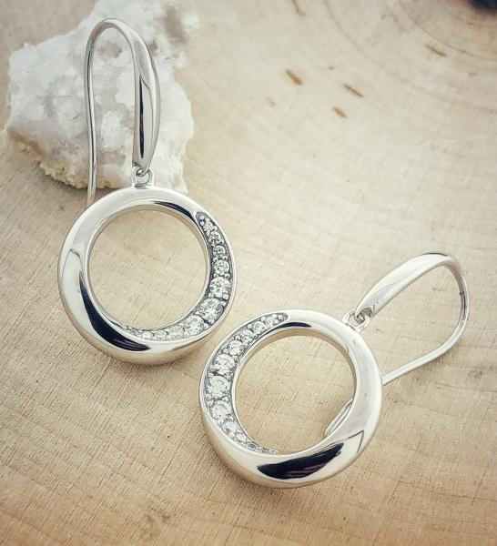 "Sterling silver and cubic zirconia ""O"" earrings. $146.00"