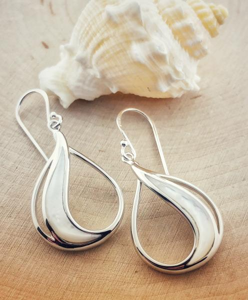 Sterling silver mother of pearl earrings. $125.00