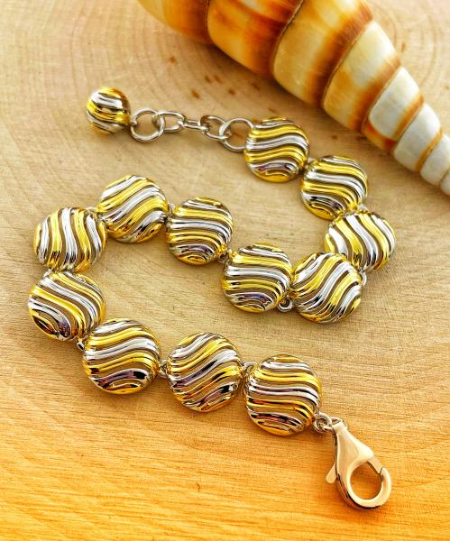 Sterling silver and yellow gold vermeil round swirl link bracelet. $660.00