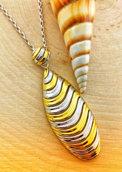 Sterling silver and yellow gold vermeil swirl design tear drop necklace. $370.00