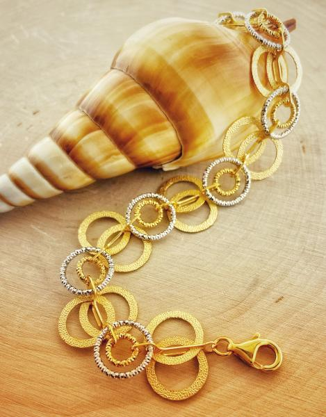 Sterling silver and gold vermeil textured circle bracelet. $325.00