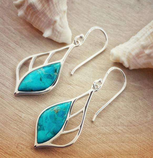 Sterling silver teardrop turquoise dangle earrings. $75.00