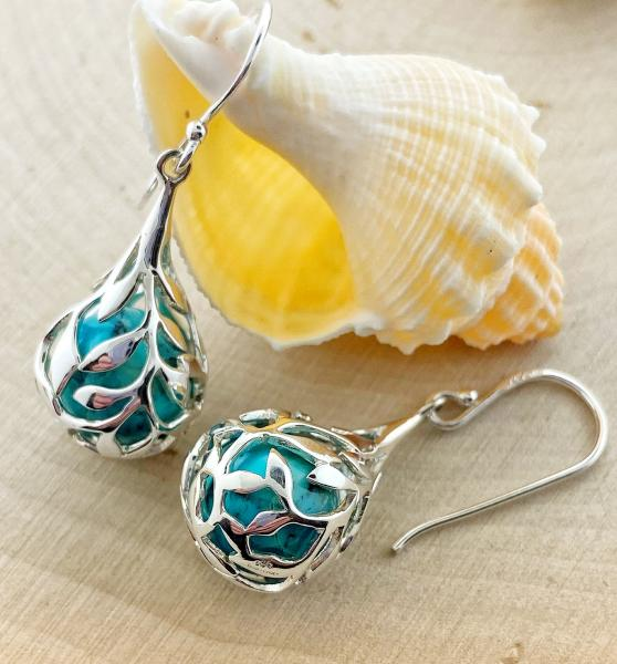 Sterling silver turquoise bead with a floral cage dangle earrings. $120.00