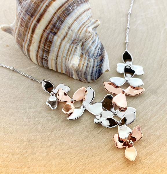 Sterling silver and rose gold overlay blossom petal necklace. $315.00